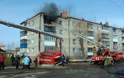 В Коркино горит квартира в многоэтажке